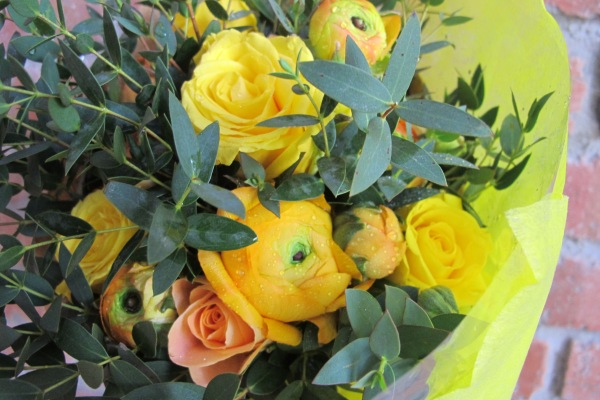 hidden amongst the mini eucalyptus are these ranunculus and yellow roses
